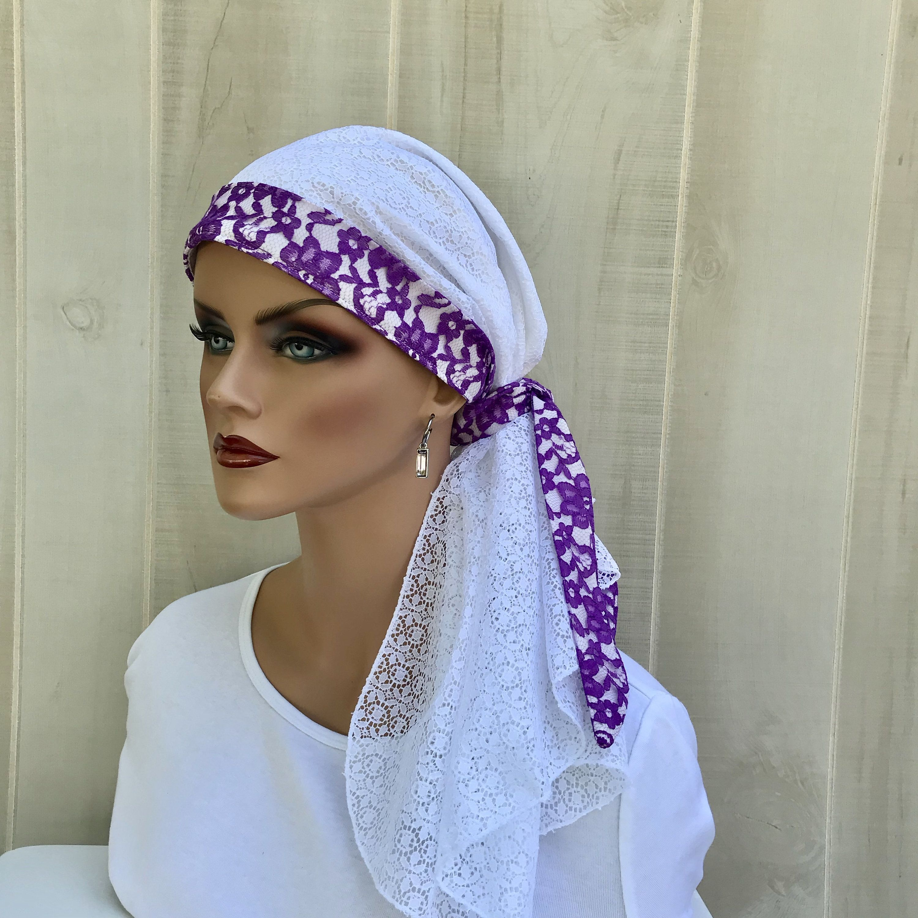 August Sale...Buy $30, Save 20%. This is our 'Carlee' #PreTied #HeadScarf For #Women With #HairLoss. #Cancer #Headwear #ChemoHats #HeadCover #Alopecia #Hat #HeadWrap #HairWrap #Turban #White  #Purple #Lace #LaceHeadWrap #Wedding #Bridal #LovemyIHC #InspirationalHeadCoverings #tieheadscarves