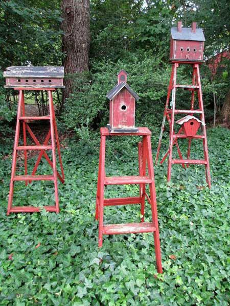 Instead of hanging birdhouses from tree branches, Barb Rosen of the blog Our Fairfield Home & Garden, mounted birdhouses on old ladders to create functional garden accents. See more of her garden here.