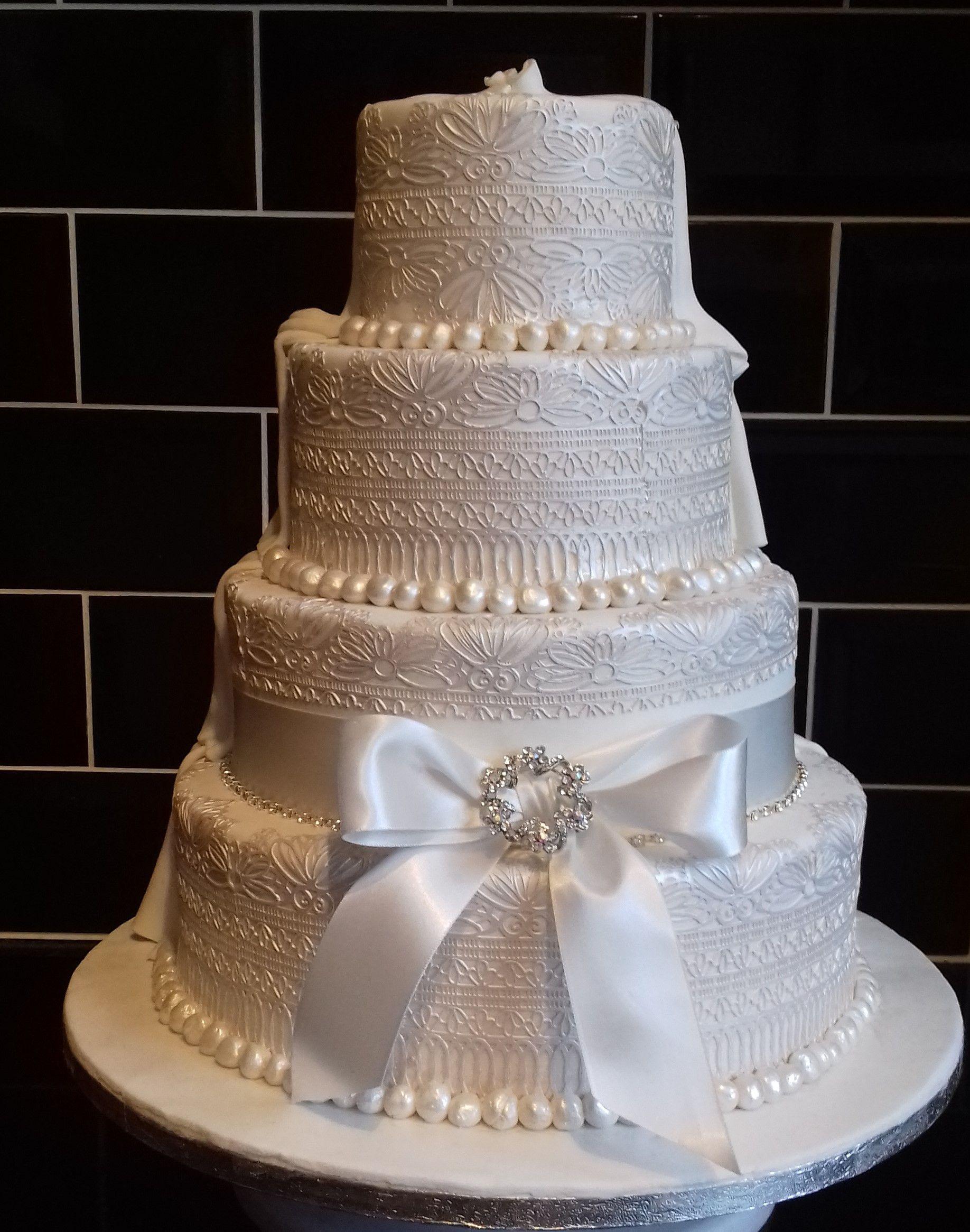 Cakes Unlimited Wedding Cakes  - Vintage Lace, Superhero half and half wedding cake