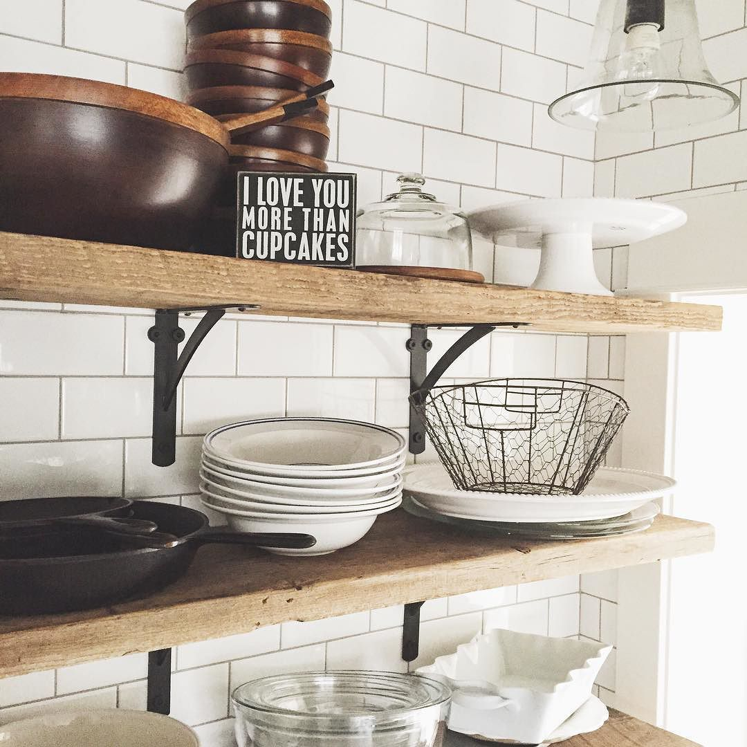 White subway tile paired with reclaimed wood shelves in a modern white subway tile paired with reclaimed wood shelves in a modern farmhouse kitchen dailygadgetfo Images