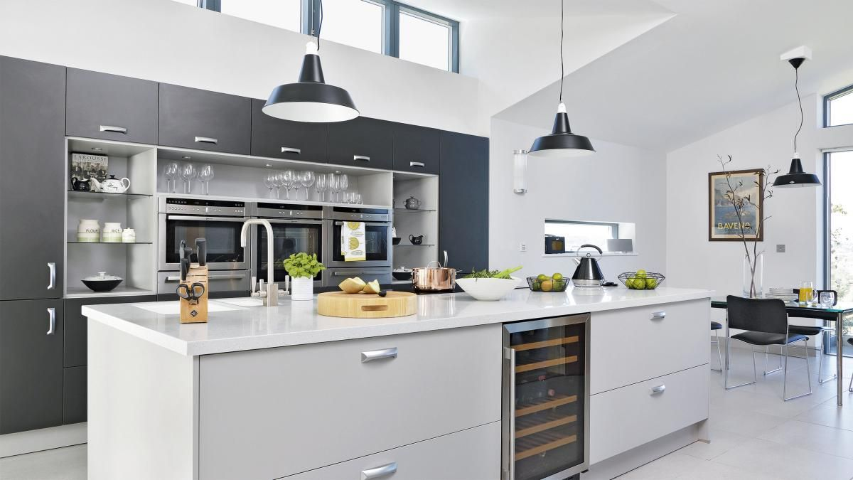 White modern kitchen with impressive island and grey cabinetry