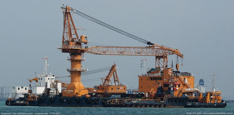 Singapore Salvage Engineers crane barge SSE JEROME and other SSE units moored at the Selat Pauh anchorage in Singapore