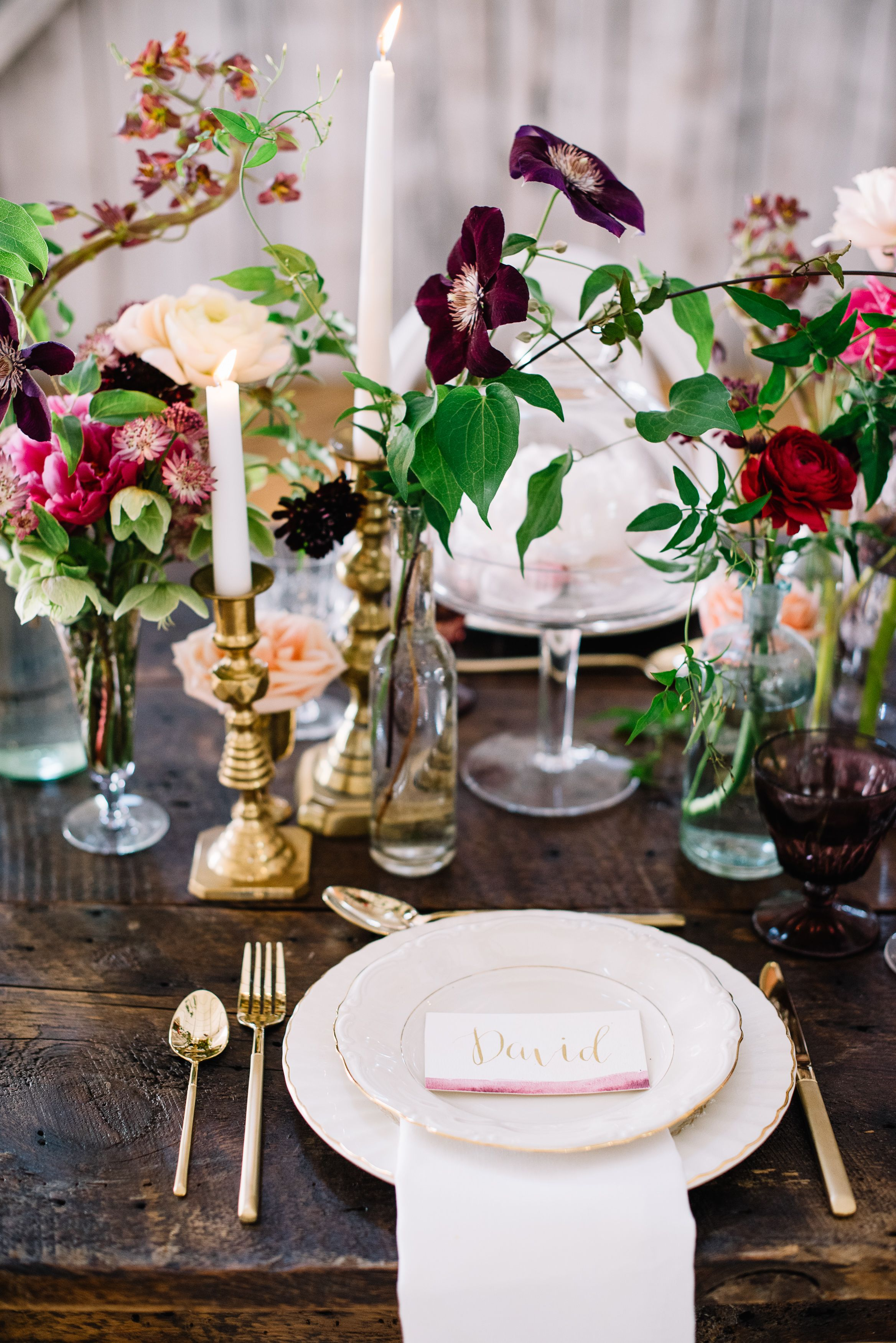 Clusters Of Miniature Wedding Centerpieces Come Together To Create A Beautiful Floral Display S Simple Wedding Centerpieces Round Wedding Tables Wedding Table