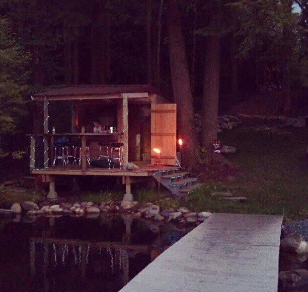 Quiet lakeside bar shed
