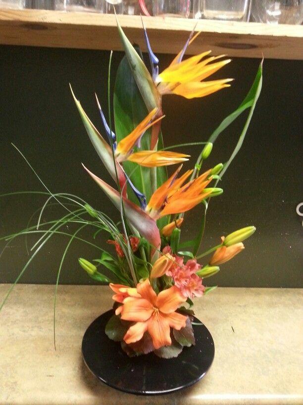 Troical orange flower arrangement for wedding and event.