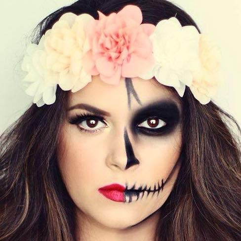 half skull halloween makeup with a big flower crown love