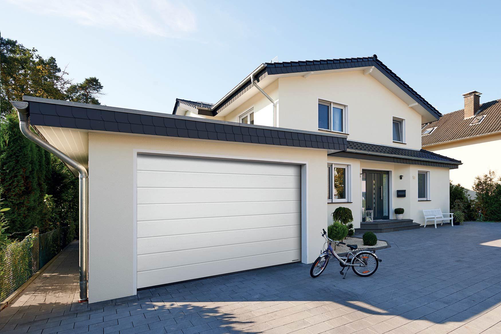 Nouvelles Portes De Garage Sectionnelles Renomatic D Hormann En 2020 Porte Garage Garage Porte De Garage Sectionnelle
