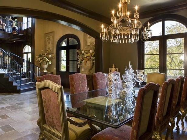 The Tuscan Style Villa Features A Formal Dining Room, A Wine Cellar, A