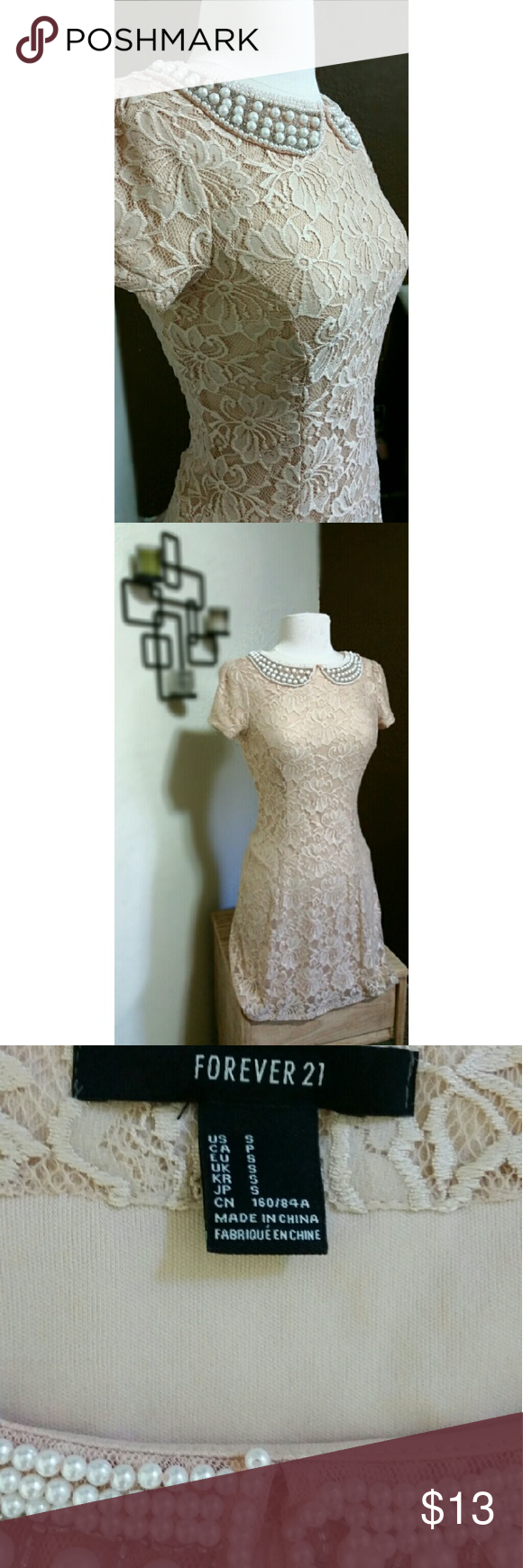 {New Listing} Lace Floral Embellished Collar Dress Feminine details & romantic silhouette. Its beautiful floral cream colored lace fabric complements the faux pearl embellished collar. Its invisible side zipper ensures a secure and seamless fit. In very good condition and is a size small. Forever 21 Dresses