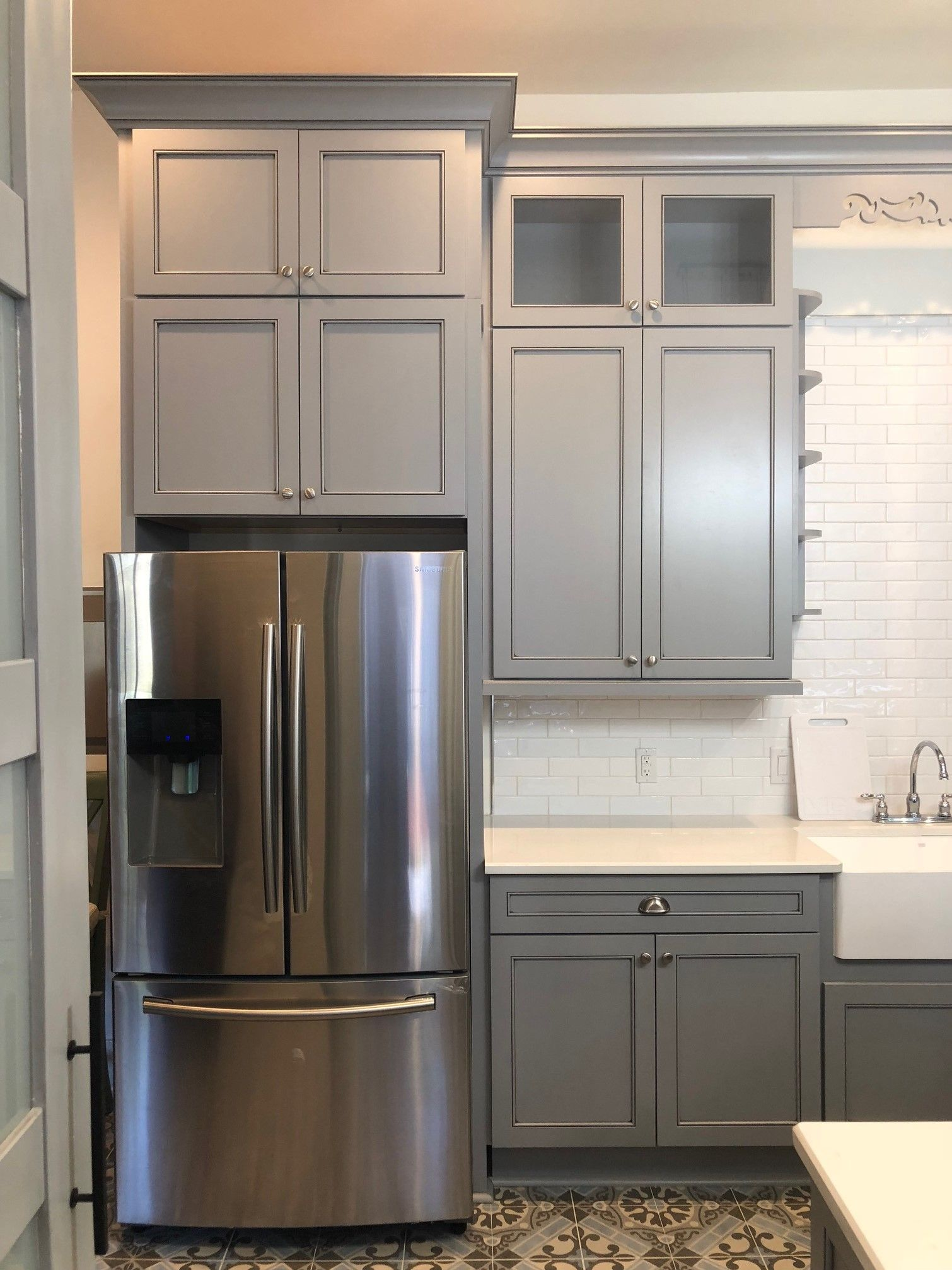 Blue Gray Shaker Cabinets Are Paired With Stunning Hand Painted