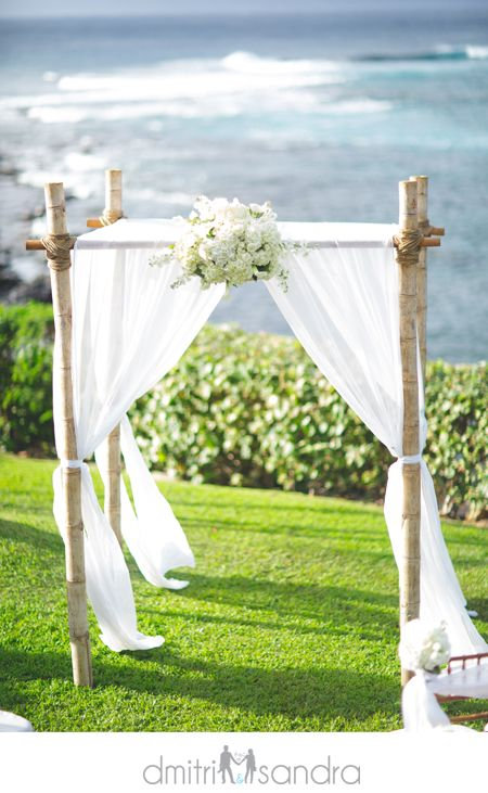 Love the flowing white curtains with greenery and some flowers...would prefer the curtain wrapped and draped though.
