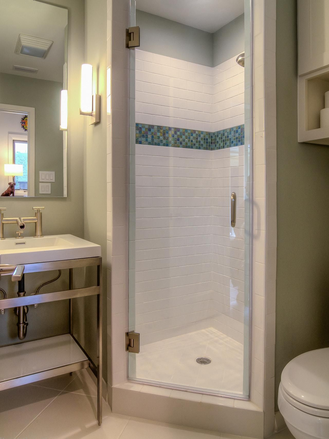 Bathroom layout shower - A Stall Shower Fits Perfectly In The Corner Of This Small Bathroom Bright White Tile