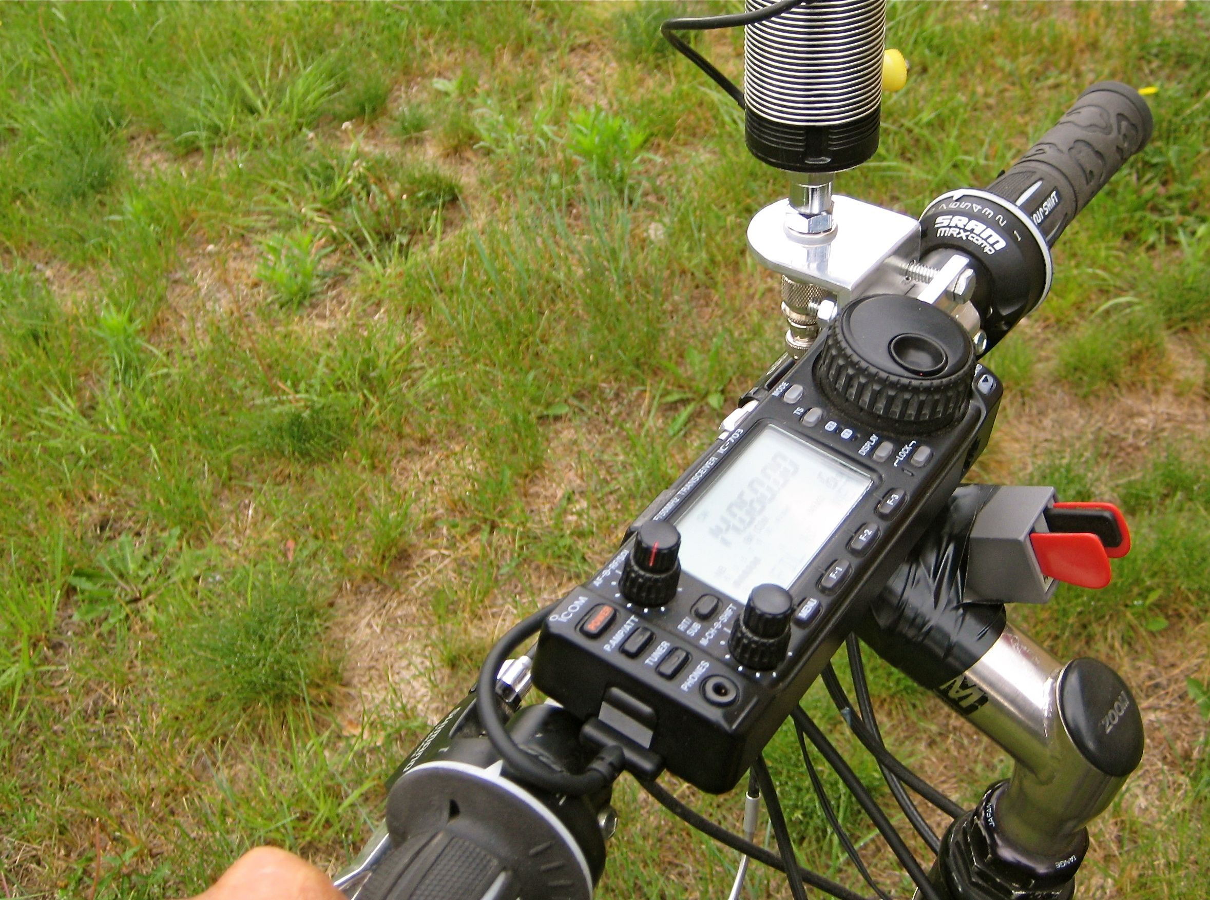 QRP ham radio via bicycle-mobile ...Icom 703, Buddipole coil and whip and Palm paddles