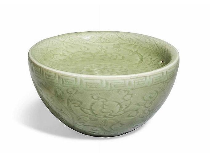A carved celadon warming bowl, Ming Dynasty, 15th century