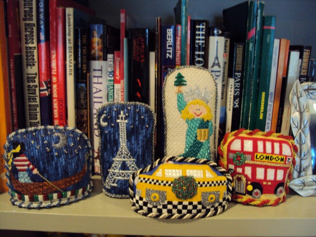 Carolyn Hedge Baird has been showing off bookshelves with needlepoint on them. I love this idea so much I'm inspired to finish lots of small things so I can put them on my shelves.