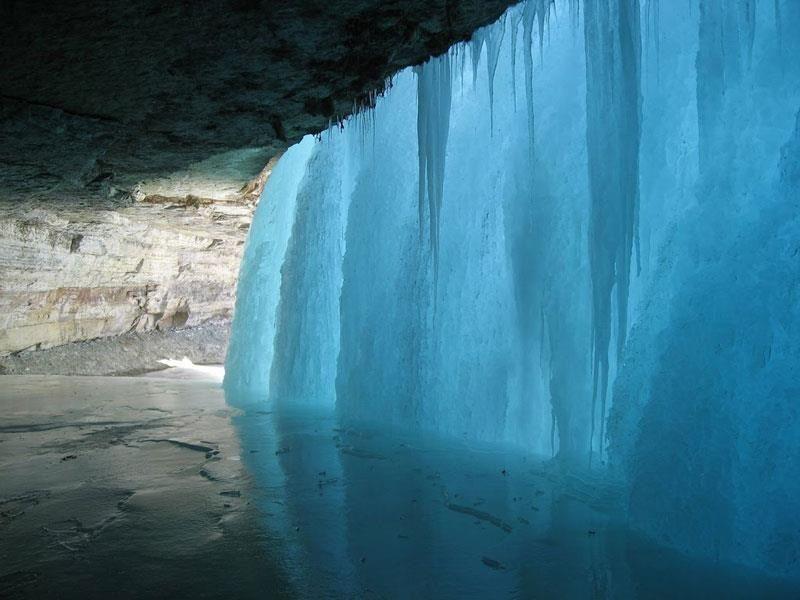 Behind the frozen water falls of Minnehaha Falls, Minnesota, Minneapolis
