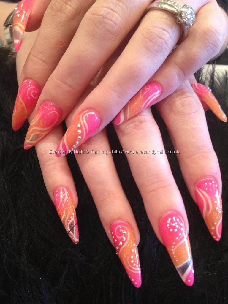 Stiletto nails with pink and orange acrylic and freehand white and ...