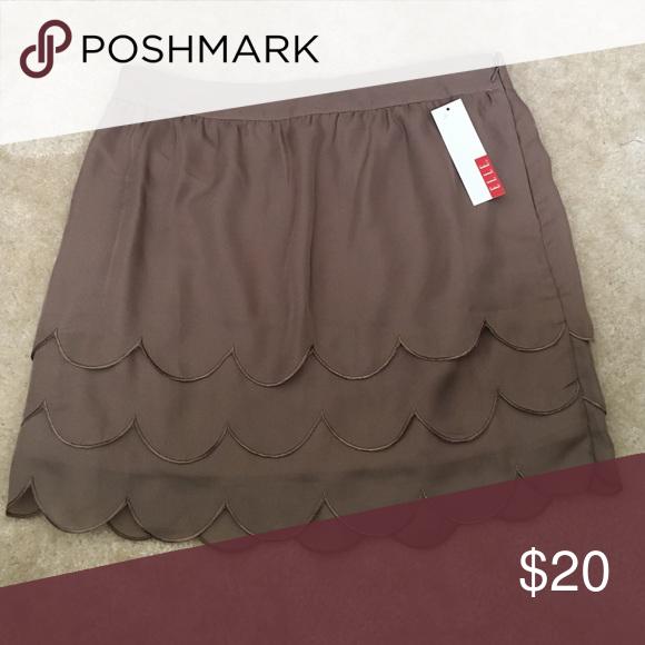 Adorable Scalloped Design Mini Shirt Light brown mini skirt. Scalloped design with 3 layers. Skirt is fully lined. Elle Skirts Mini