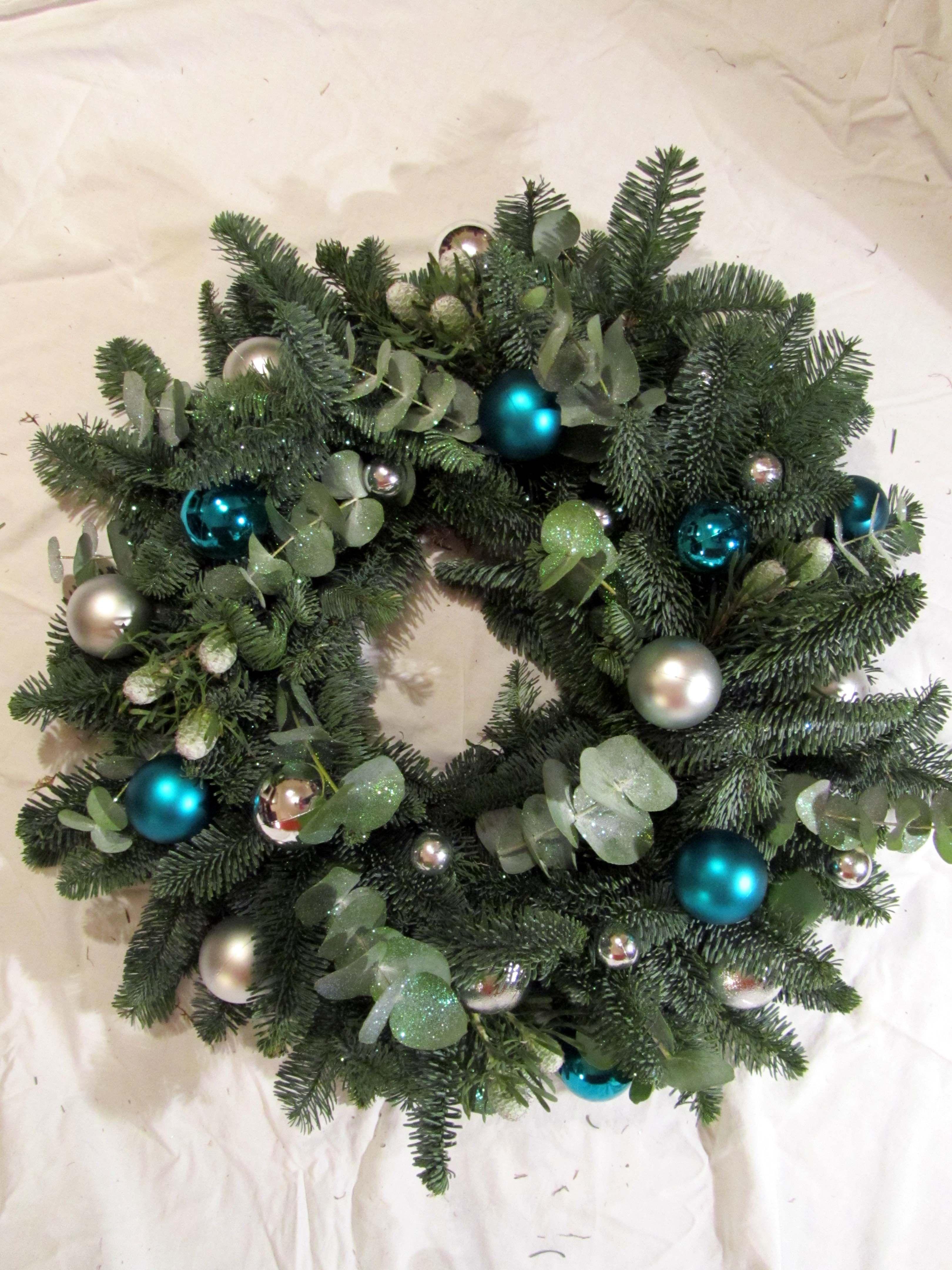 Boutique Blooms Floral Design Blue Fir Eucalyptus Glitter Teal And Silver Ornament Christmas Door W Christmas Door Wreaths Christmas Wreaths Floral Design