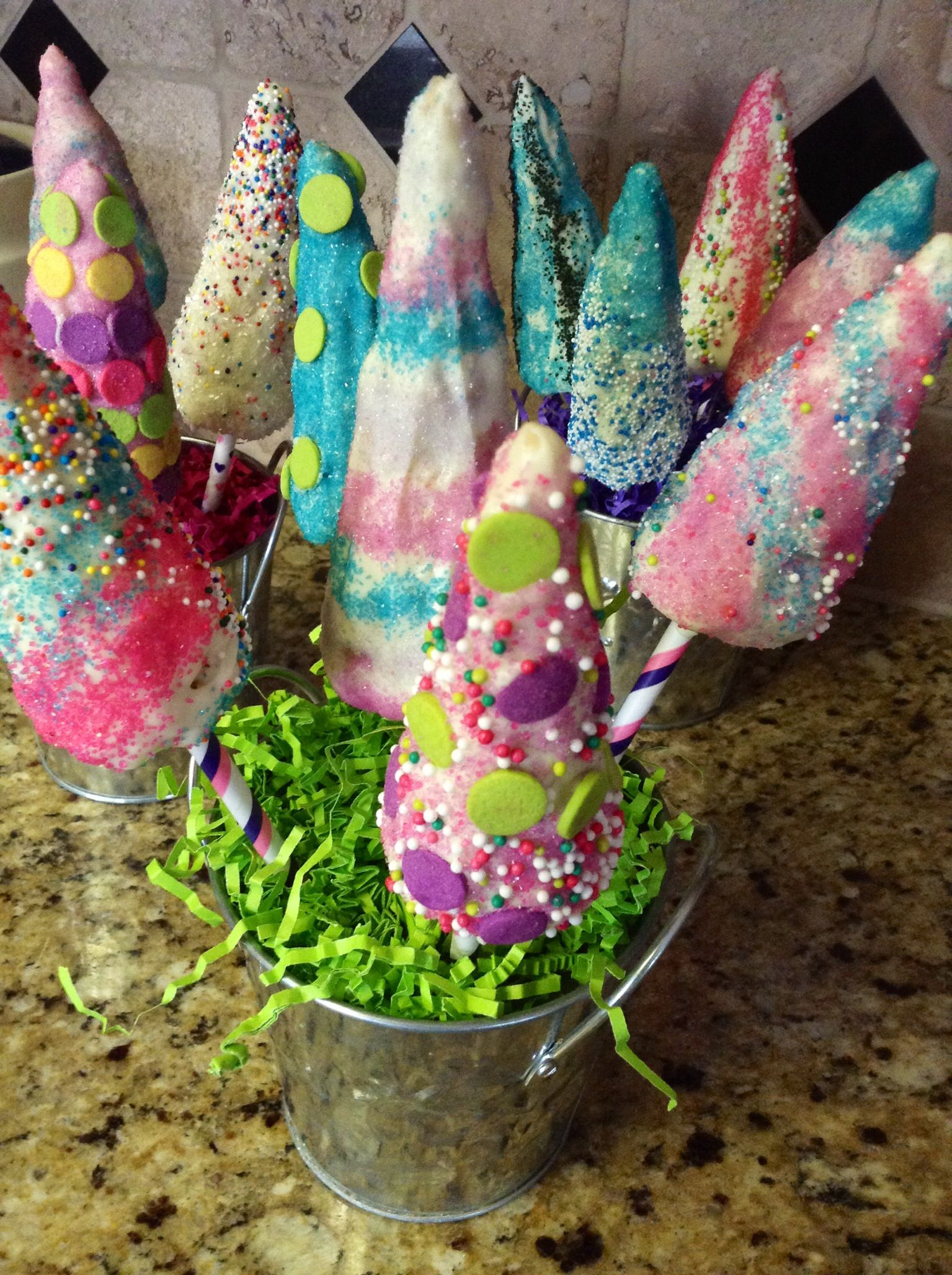 We made unicorn horns out of Rice Krispie treats, dipped ...