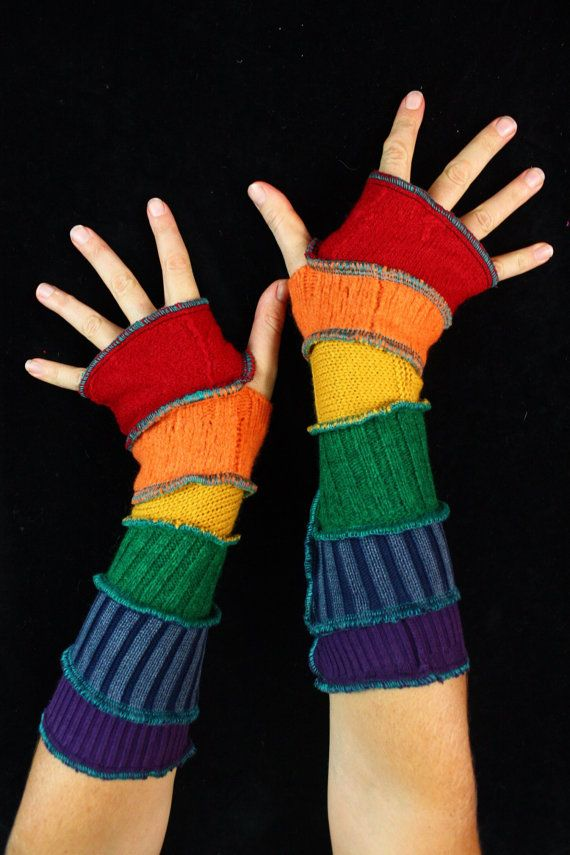Here is a great pair of arm warmers made from bits of recycled knits. They have a rich palette of bold rainbow. Enjoy!  ************************************************************************************************************  About Katwise Sweaters:  I started making recycled patchwork hoodies 20 years ago, while I was a wee gypsy girl, following the Grateful Dead. Since then my style has evolved and grown into this etsy maddness. I have made thousands and thousands of sweaters, and…