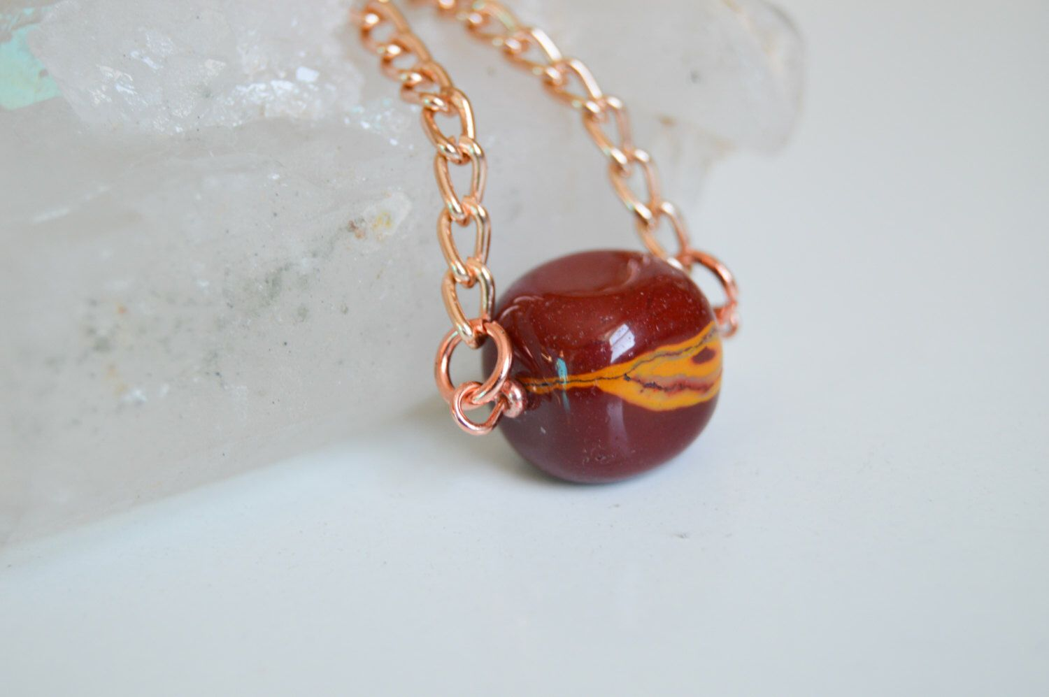 Red jasper crystal pendant nugget with rose gold tone necklace by