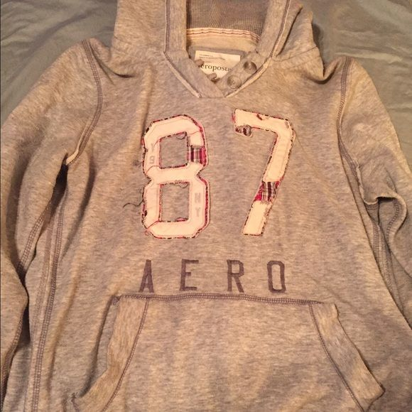 """Aeropostale Hoodie Grey Aero hoodie, excellent condition. 87 on the front, """"torn"""" look with plaid. Super cute buttons at the top! Aeropostale Tops Sweatshirts & Hoodies"""