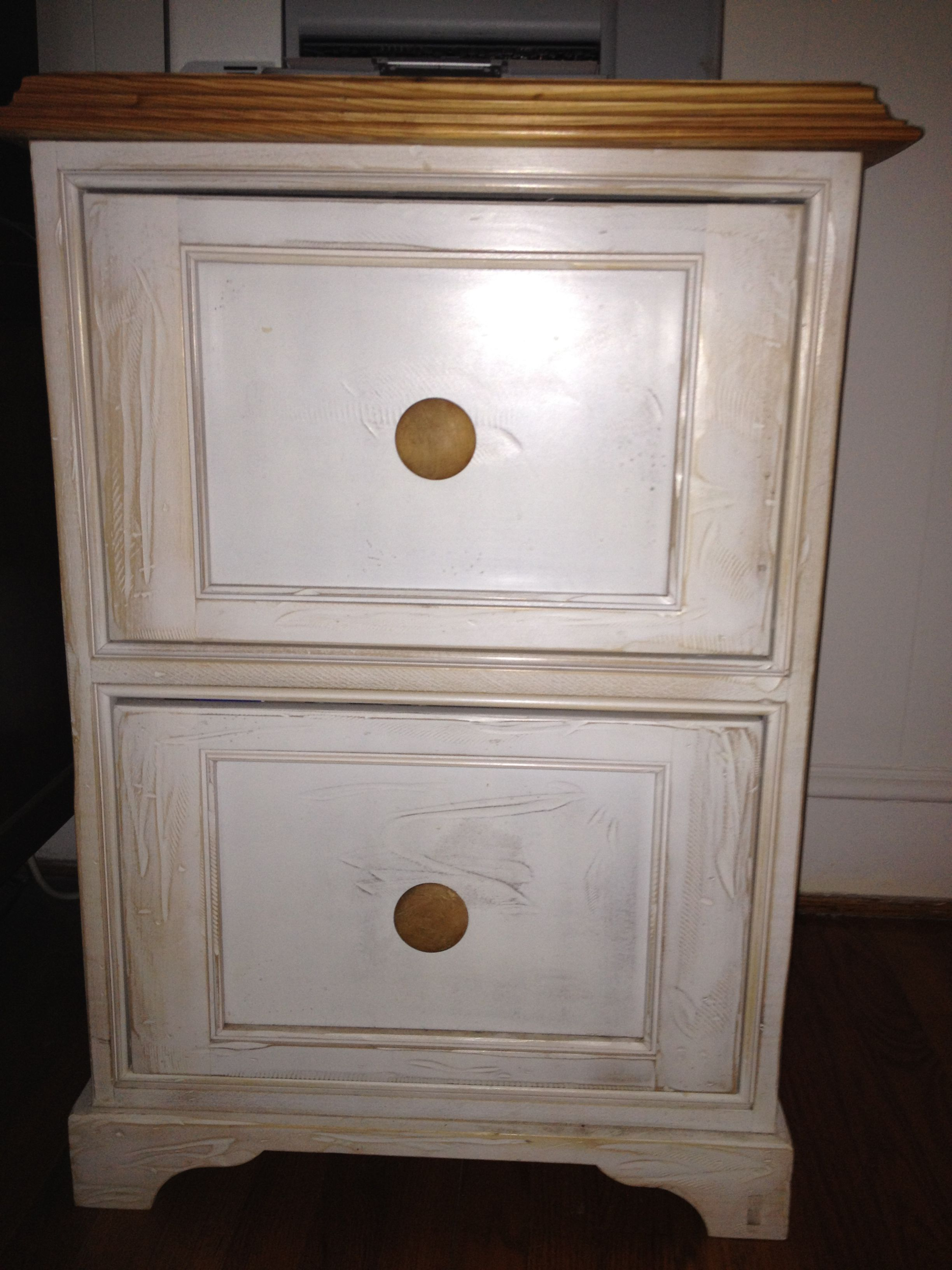 This painted white wooden filing cabinet has a traditional feel with