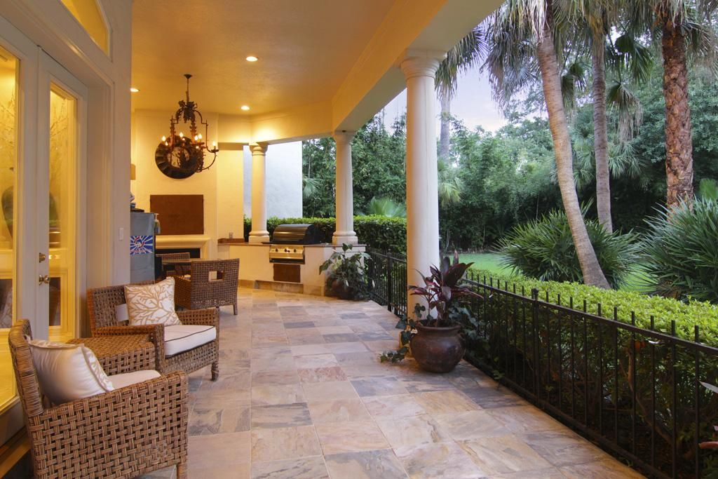 Elegant summer kitchen with outdoor grill and fireplace! Covered patio excellent for relaxing in the shade.