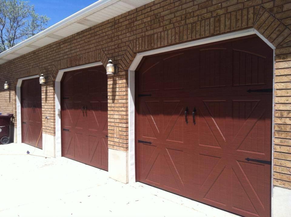 Http Www Aplusgaragedoorsutah Com Layton Ut Have More Than One Garage Bay Here Is A Beautiful Ex Residential Garage Doors Garage Doors Wooden Garage Doors