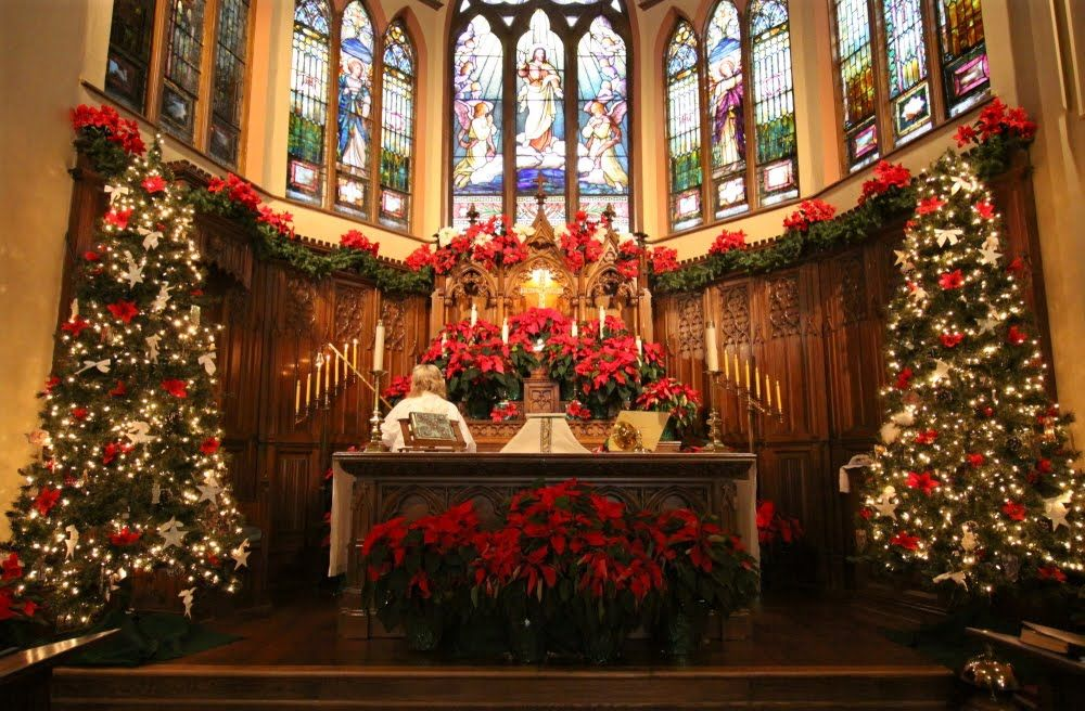 A protestant church altar decorated for pentecost with red for Christmas church decoration ideas