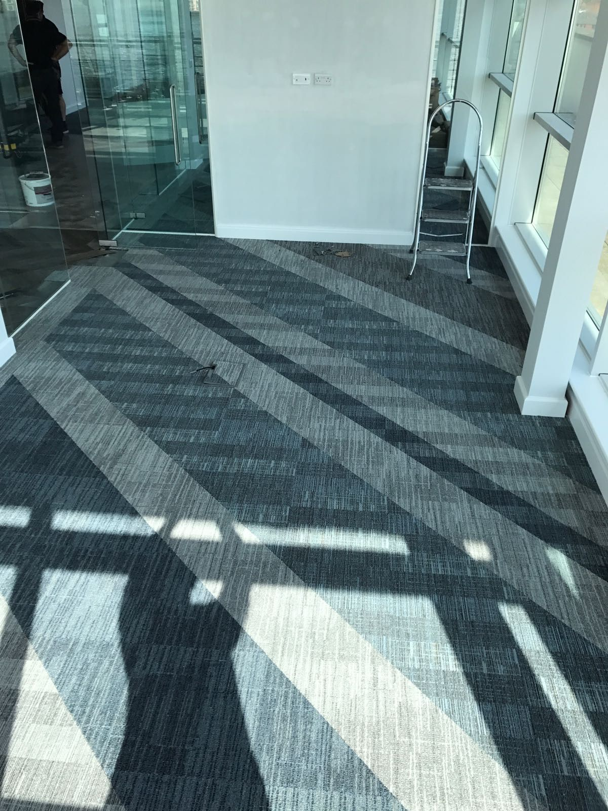 We Just Love How These Carpet Tiles Turned Out A Sea Of Blue And Grey Carpet Tiles Feature In This Comm Carpet Tiles Stair Runner Carpet Flooring Inspiration