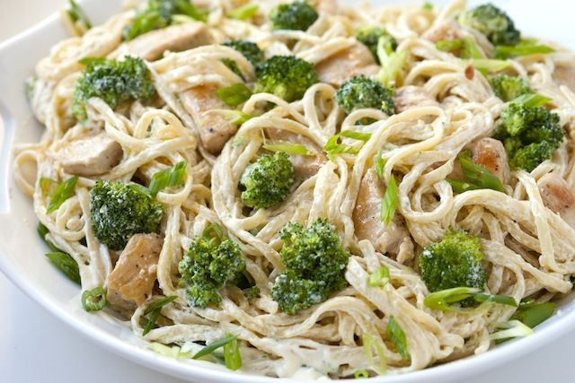 Creamy Miso Chicken Pasta  1 pound pasta  2 cups broccoli florets  2 tablespoons olive oil  2 boneless skinless chicken breasts, cut into 1-inch pieces  2 tablespoons unsalted butter  2 tablespoons Miso & Easy or see above for miso paste substitution  1 1/2 cups Greek yogurt  1/2 cup shredded Parmigiano-Reggiano cheese  2 green onions, finely sliced  salt and pepper