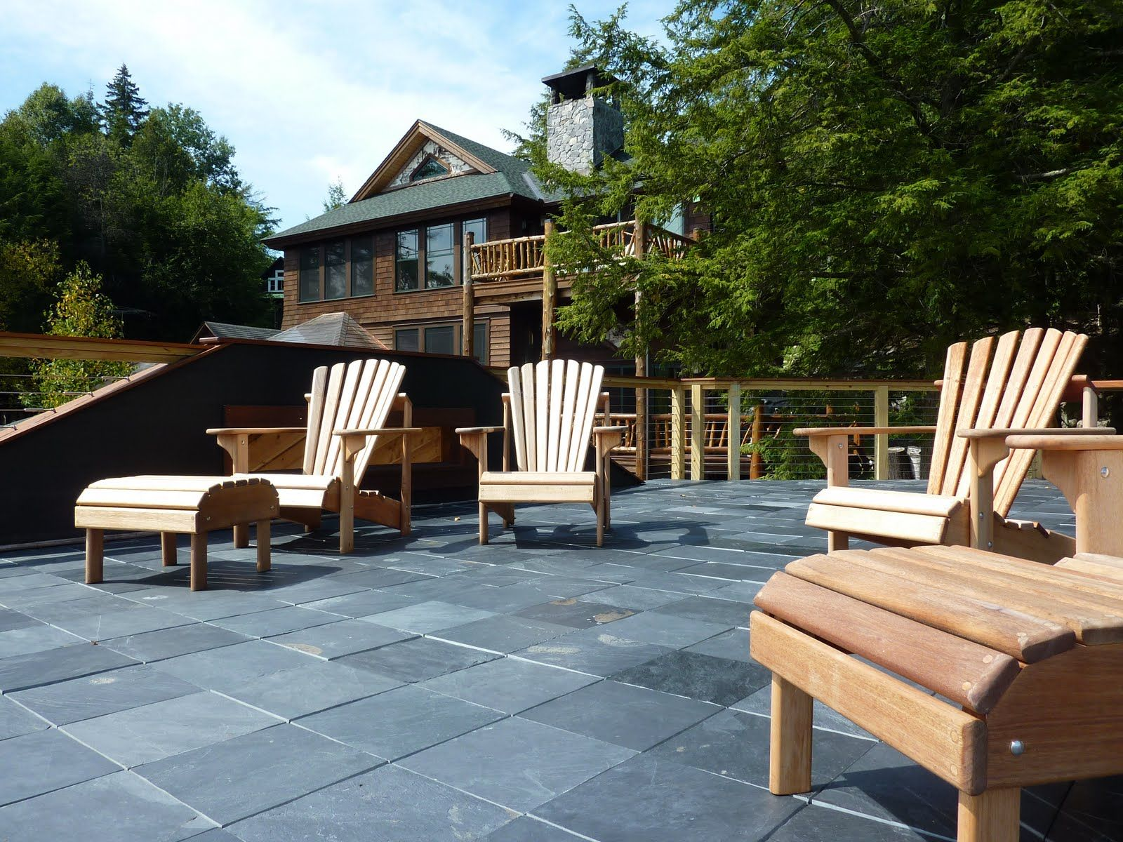 Classic grey slate interlocking patio tiles covering an old wood