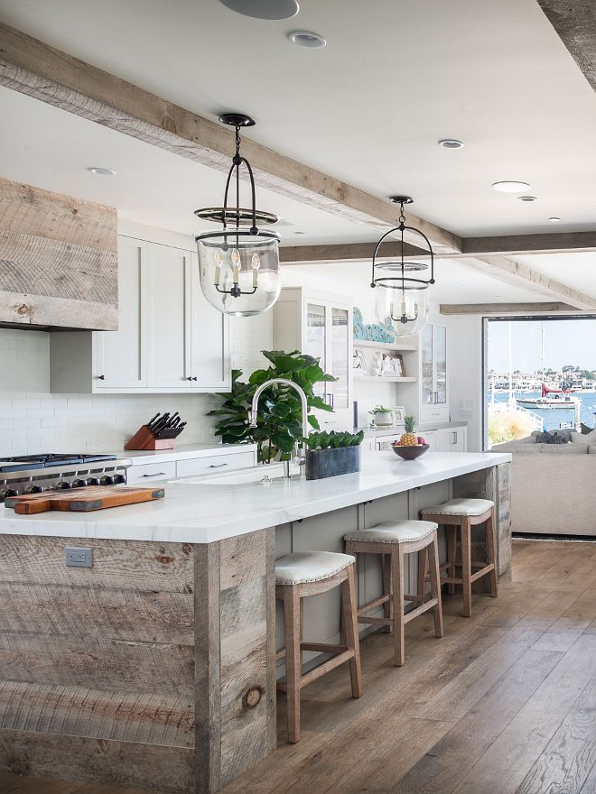 Rustic Kitchen island with reclaimed shiplap and Michaelangelo Calcutta honed countertop Rustic Kitchen island with reclaimed shiplap, reclaimed shiplap hood and reclaimed wood beams #RusticKitchen #reclaimedshiplap #rustickitchendesigns