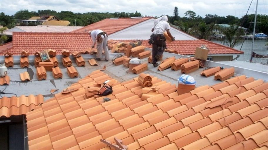 How Much Does A Tile Roof Cost Roof Installation Patio Roof Roof Cost