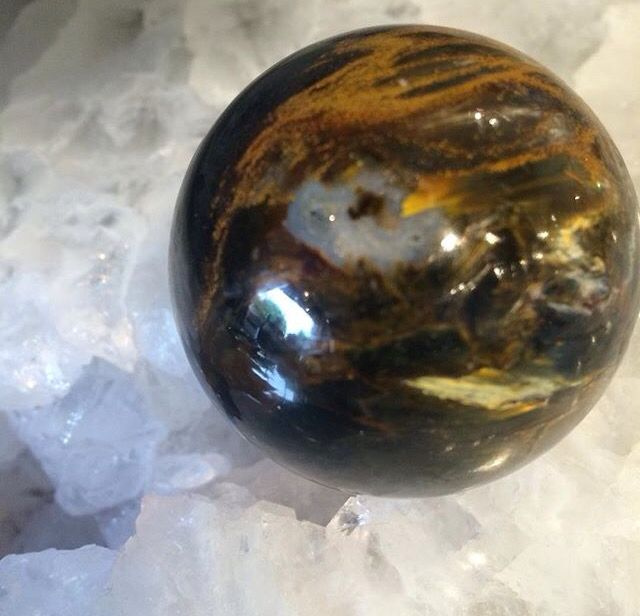 Silky black and gold Pietersite sphere from South Africa.