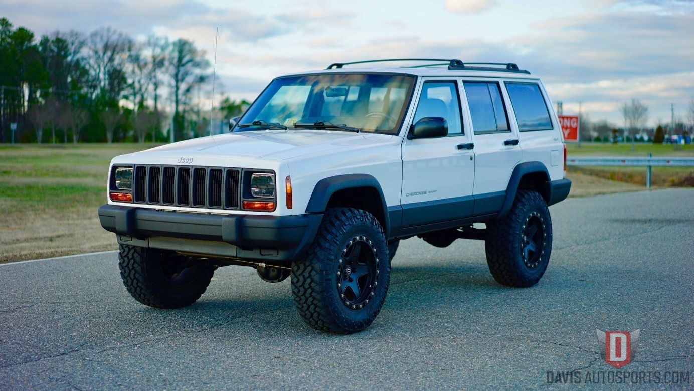 White Older Jeep Cherokee
