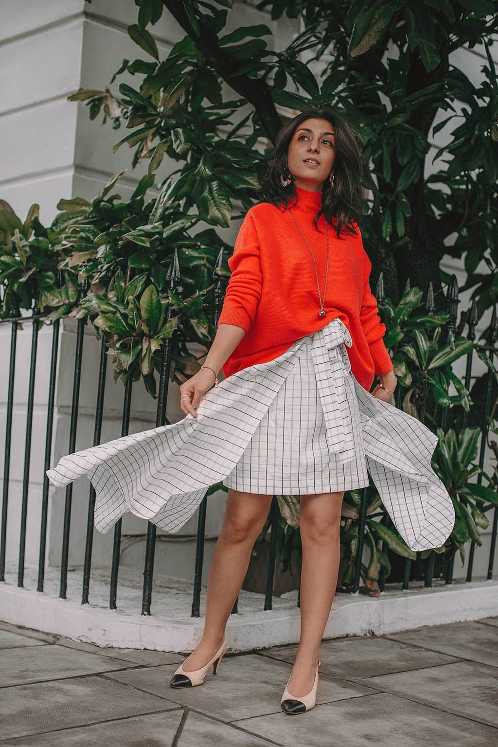 63f5fe8b6 Fashion blogger Shloka Narang of The Silk Sneaker shares how to create the perfect  spring outfit while styling an asymmetrical skirt featuring Deme by ...