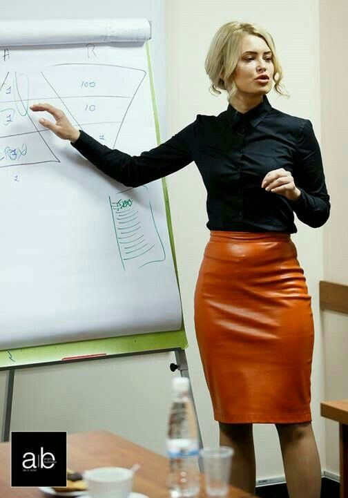 5c65e4c60a47 Businesswoman in tight orange leather pencil skirt | Hanging 2 in ...