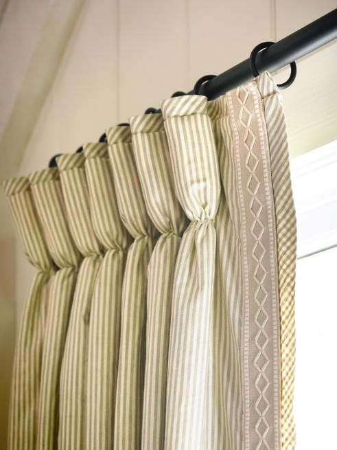 Goblet Pleated Drapes Embellished With A Banded Trim Down The Lead