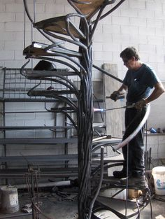 Best Hand Forged Iron Work For A Spiral Staircase Laying In 400 x 300