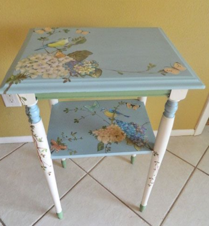 Fabulous upcycled side table with delightful decoupage makes for a stunning piece.