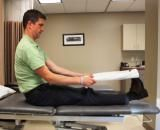 The Towel Calf Stretch: Use a towel wrapped around the ball of the foot to stretch the calf muscle.