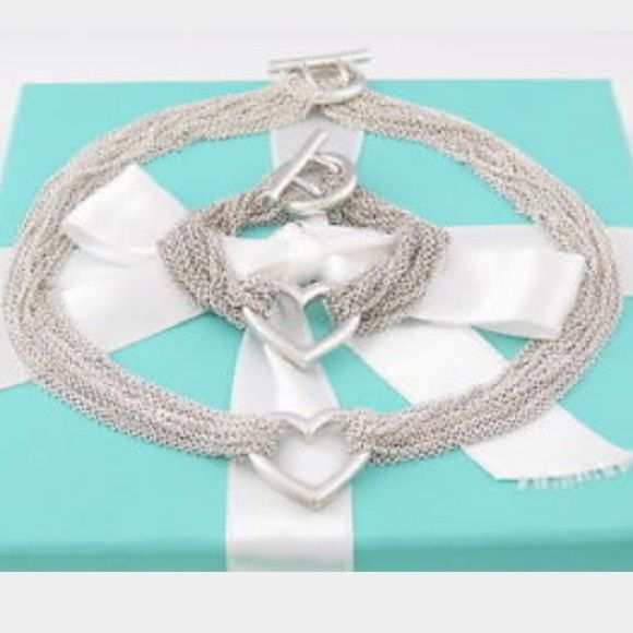 $1,800 GORGEOUS 2pc MULTI STRAND TIFFANY & CO. SET $1,800 SUPER RARE GORGEOUS 2pc MULTI STRAND HEAVY STERLING SILVER TIFFANY & CO. SET WITH ORIGINAL BOX, AND DUST CLOTH. NO LONGER SOLD IN STORES SO THE LONGER YOU KEEP IT THE MOST ITS VALUED. BRACELET MEASURES: 18.5cm LONG AND NECKLACE MEASURES: 40.1cm LONG. WILL MAKE EVERYONES HEADS TURN WHEN YOU WEAR IT. 200% AUTHENTIC, ONLY WORN A FEW TIMES NO TARNISHING OR SIGNS OF WEAR. •••REASONABLE OFFERS WELCOME THROUGH THE OFFER OPTION, NO TRADES OR…