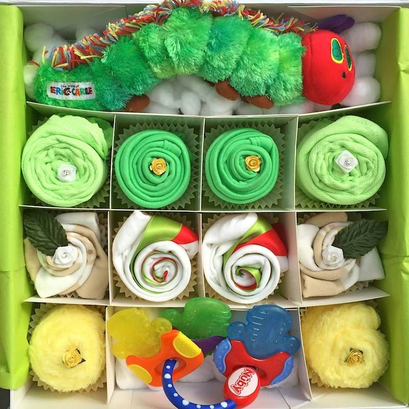 I am sure a lot of people will remember the wonderful Hungry Caterpillar story from their childhood. This cupcake gift set will bring back memories and makes a perfect gift for a beautiful baby girl or baby boy. Comes presented in a large white gift box and tied with green and red ribbon and wrapped in celophane.