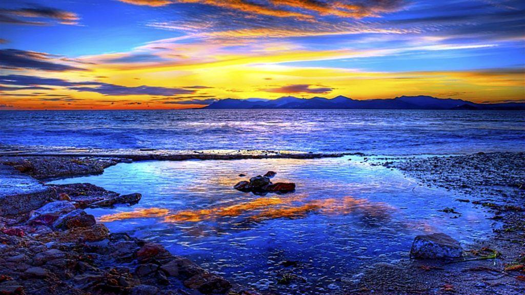 beach blue reflection ocean wave beach rocks wallpaper 4k
