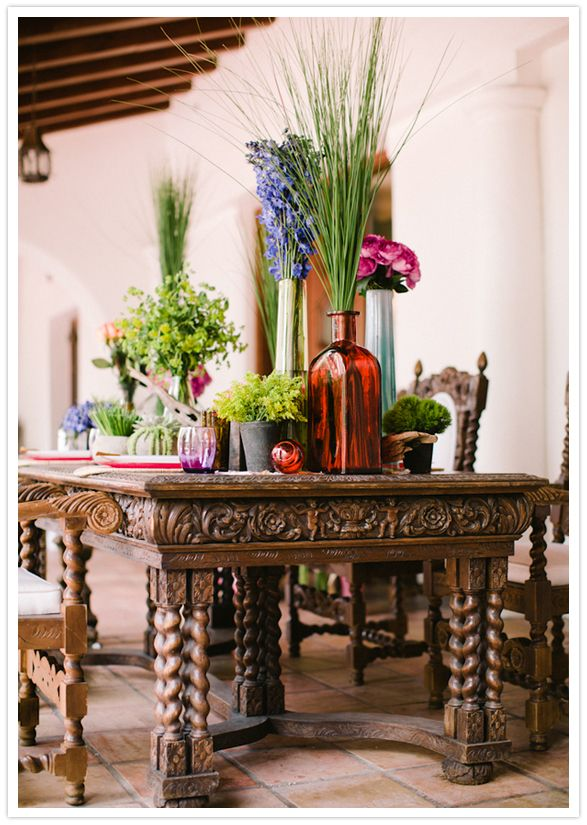 love this ornate moroccan style dining table and floral accents