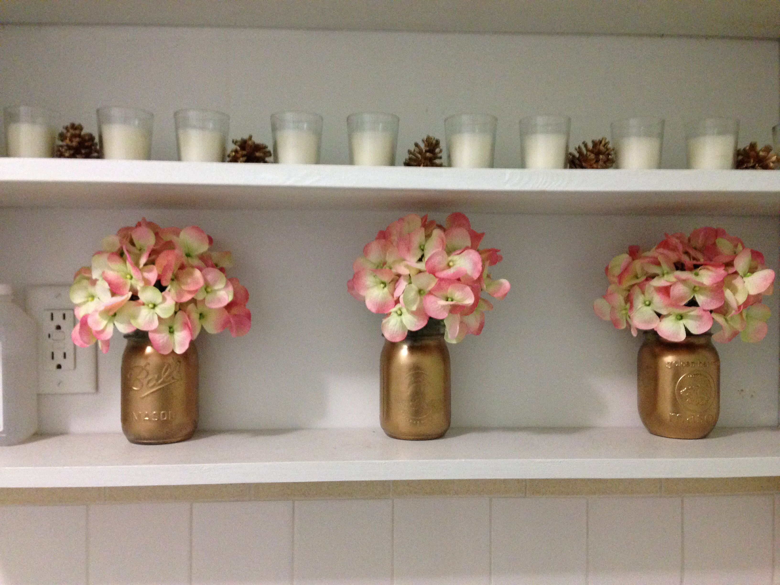 Grouping of three like small vase flower arrangements ...