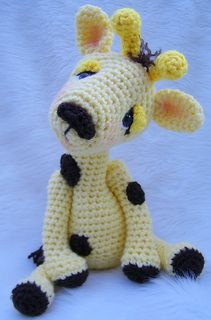 """Make this sweet giraffe using basic crochet stitches, worsted weight yarn and size G hook. Pattern includes detailed written instructions (in English), material list, photos and helpful notes and tips to complete project. Finished size approx. 13""""."""